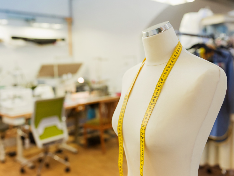 sewing mannequin with a tape measure